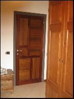 Nexus - door in walnut and Meranti